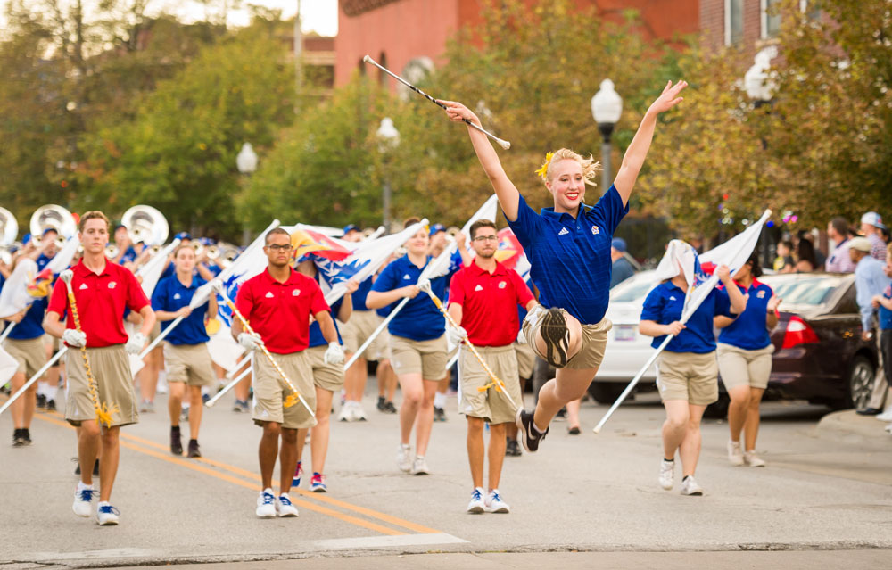 Marching Jayhawks and twirler in the Homecoming parade